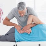 chiropractic treatment on male patient