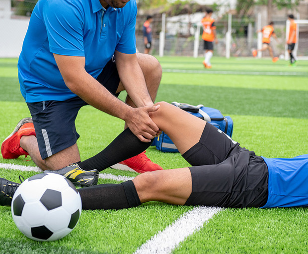 injured soccer player getting treatment on knee